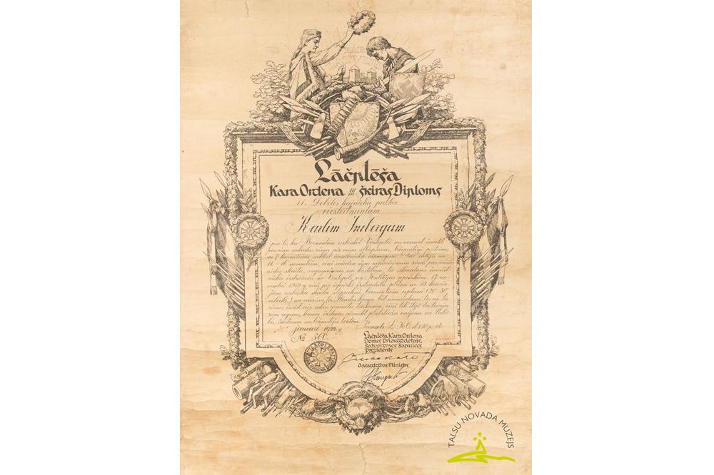 Lāčplēša Kara ordeņa III šķiras diploms Nr. 560, piešķirts 11. Dobeles kājnieku pulka virsleitnantam Kārlim Šnēbergam Jāņa d. (1892-1943) par izlūku darbību 1919. gadā no 11. līdz 16. novembrim Ventspils – Kuldīgas apkārtnē un 17. novembrī pie Stendes kroga pret Bermonta armijas posteni. 1922. gada 31. janvāris.